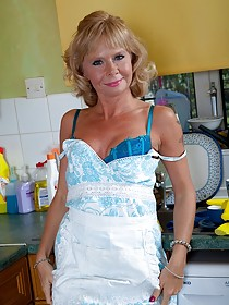 Blond-haired GILF does dishes and masturbates in the kitchen