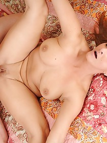 Redheaded MILF with natural breasts gets fucked sideways on camera