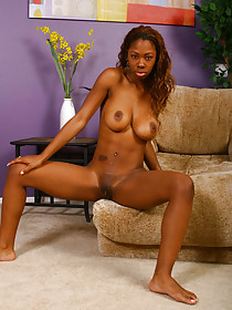 Ebony seductress fucks her brown pussy with a big purple toy